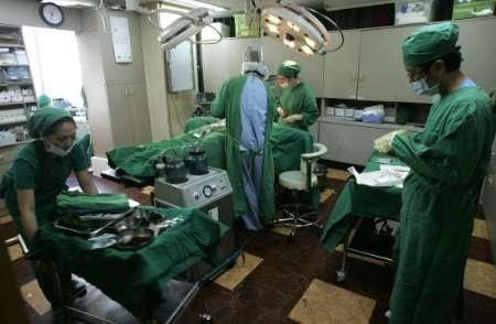 Plastic surgeons prepare to perform surgery at an operating room in BK Clinic in Seoul August 28, 2007.